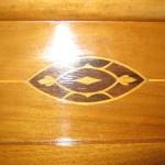 Detall decoratiu de la marqueteria del capçal